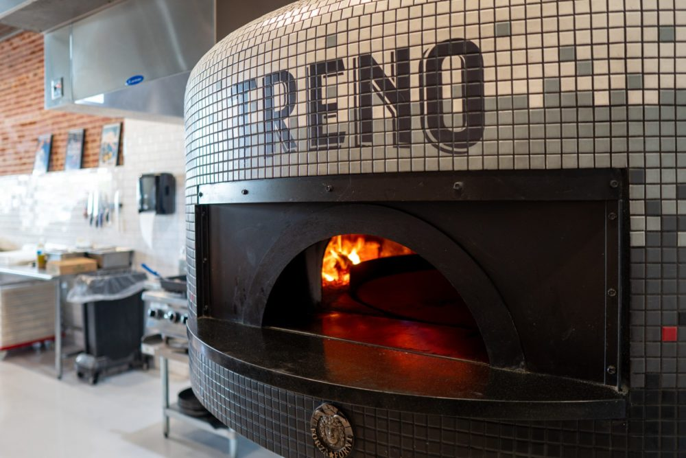 Our state-of-the-art brick oven for making fresh pizzas for our customers.